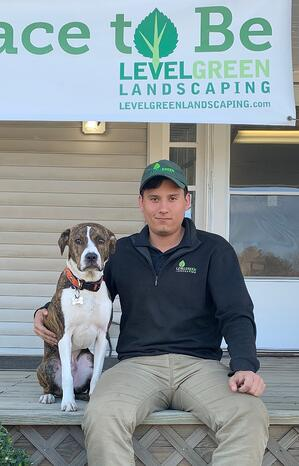 Gabe Hohman Level Green Landscaping employee with dog