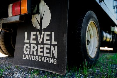 Level Green Landscaping sign on truck