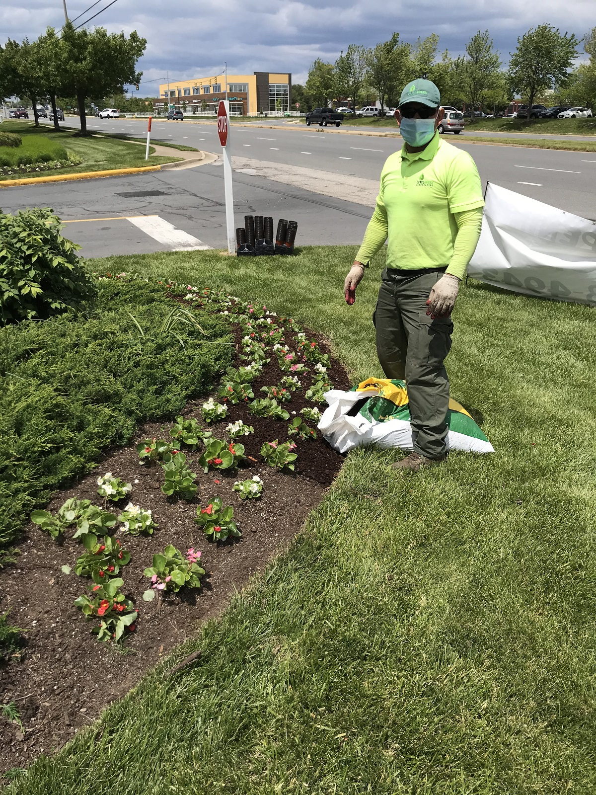 Level Green Landscaping crew member with face mask