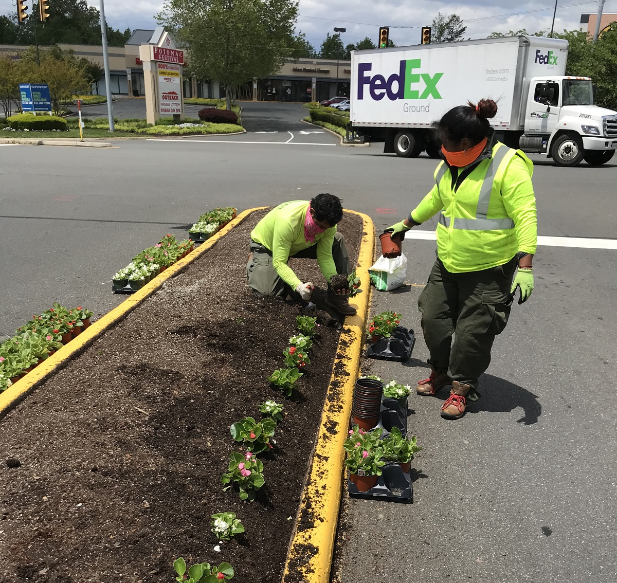 Level Green Landscaping crew members wearing masks for safety