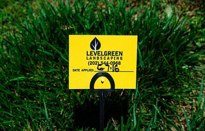 Level Green Landscaping sign in grass