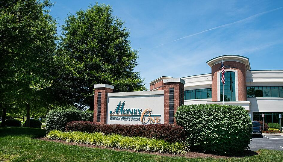 Landscaping around signage to improve property's visibility