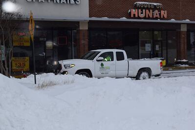 Level Green Landscaping commercial property snow removal truck