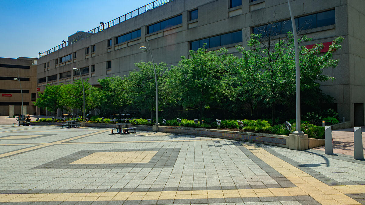 paver patio outside hospital installed by commercial landscapers