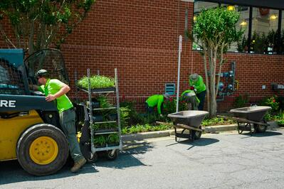 Level Green Landscaping crew on commercial property