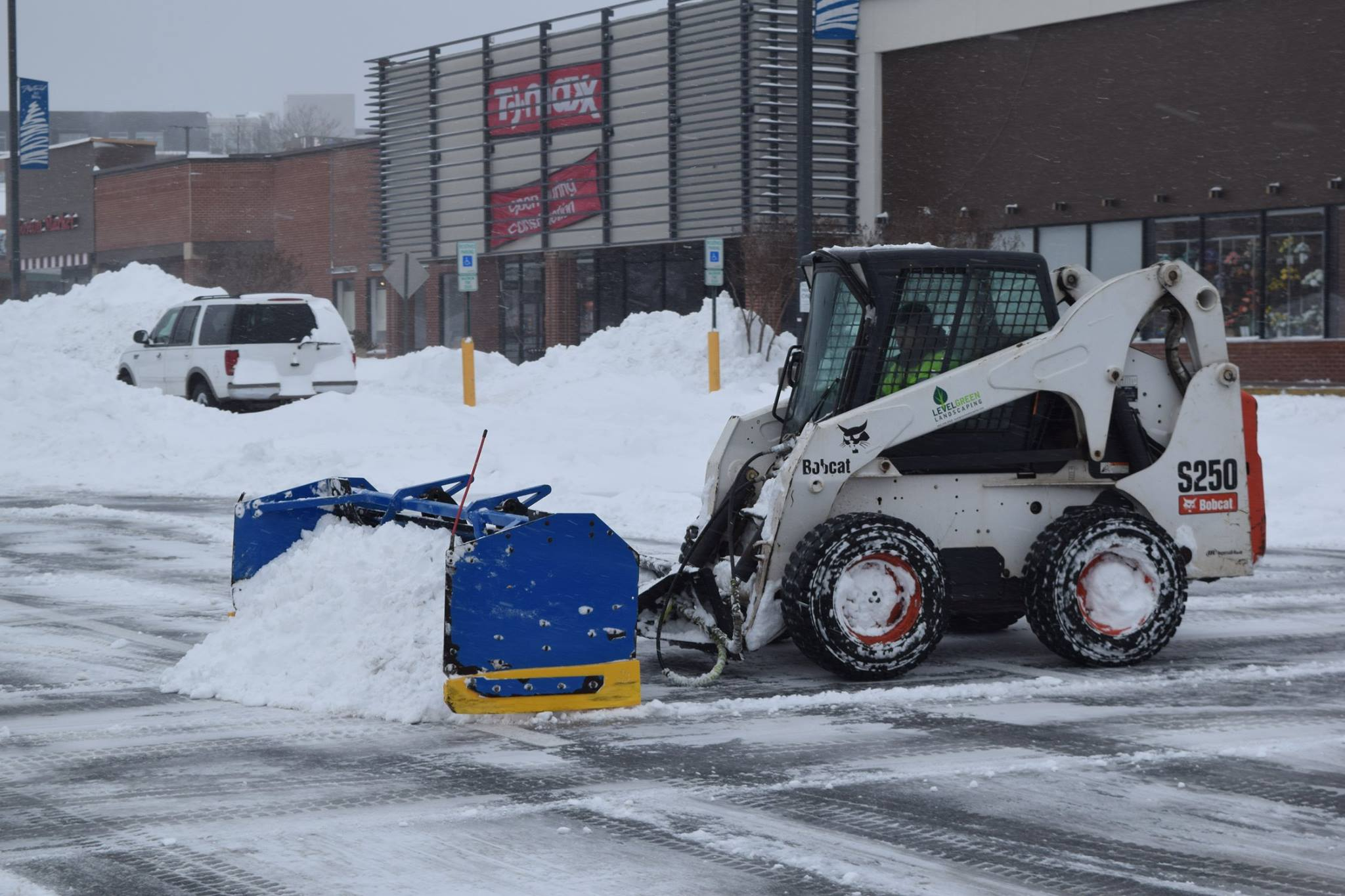 Skidsteer and pusher box used for commercial snow removal