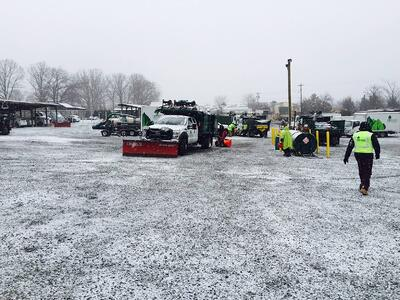 Level Green Landscaping snow removal workers and snow plows
