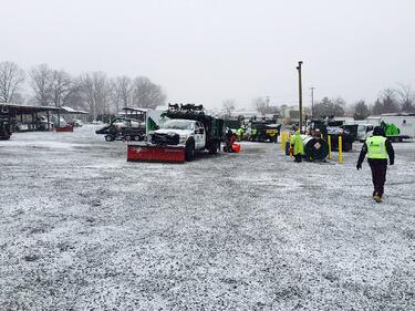 Level Green landscape snow removal trucks and crew