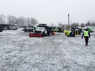 snow_removal_workers_and_snow_plows.jpg