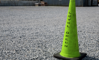 A Level Green Landscaping Safety Cone on a DC Property