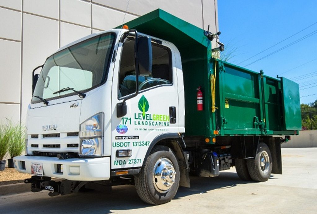 a pristine level green landscaping vehicle