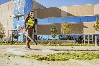 Level Green Landscaping employee using STIHL power tool