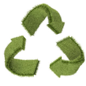 Recycling symbol in grass texture