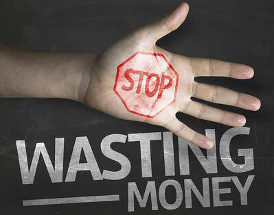 """stop wasting money"" text on blackboard"