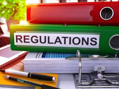 Regulations folder on desk