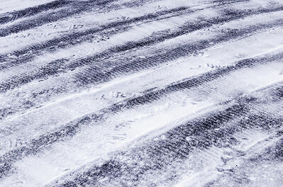 road with refreeze after snowstorm