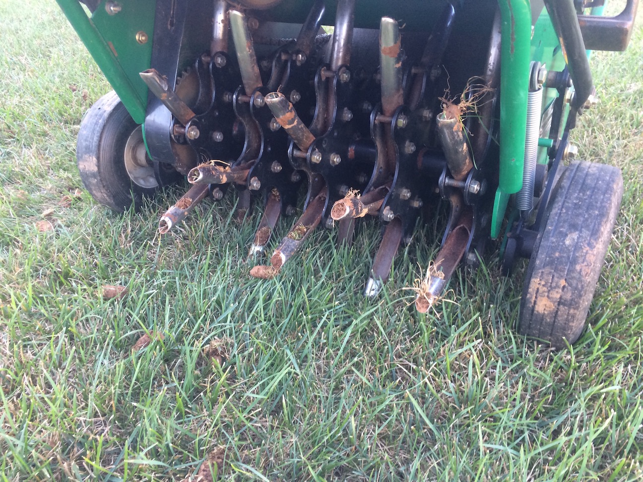 Core aerator pulling out soil to add oxygen to the roots